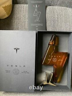 Tesla Tequila with box and stand. Sold out on Tesla. Com